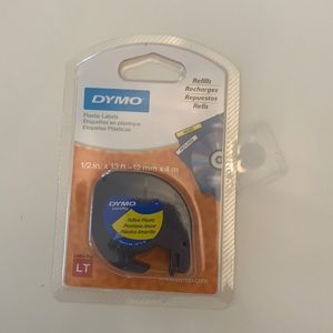 Dymo. 1/2 inch. Yellow plastic label paper